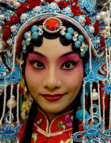 Beijing Opera star Chen Juen Juen poses in her finery before a special Beijing Olympics performance, August 10, 2008